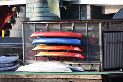 Image of kayak and Canoes on coast Stock Image