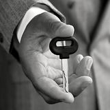 Key and hand. Image of key in hand after passing a driving test Royalty Free Stock Images