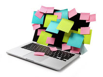 Image of laptop full of colorful sticky notes reminders on scree Stock Photo