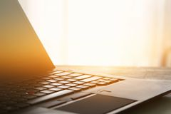 Image of laptop over wooden desk at office, workplace or home. Vintage filtered. stock images