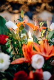 An image of a large vase of Wedding flowers with candle in a church Royalty Free Stock Photography