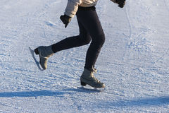 Image of Legs Young Girl in leather Figure Skates who are Skating at the Ice Rink Stock Photography