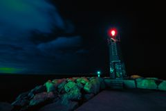 Image of a lighthouse by night. Long exposure shot with a lighthouse by night stock photo