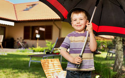 Image of a little boy with a big umbrella Royalty Free Stock Photography