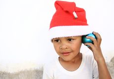 Little boy with blue christmas ball Stock Images
