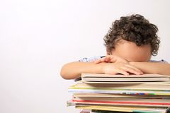 Little boy sleeping on a pile of books. Image of little boy sleeping on a pile of books Stock Photography