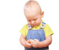 Image of little boy with tangerine in his hands Stock Photo