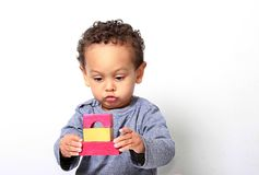 Little boy testing his creativity by building towers with toy building blocks. Image of little boy testing his creativity by building towers with toy building royalty free stock photos