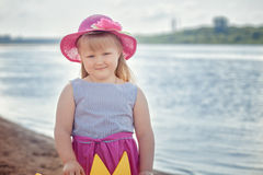 Image of little fair-haired girl posing at camera Royalty Free Stock Image