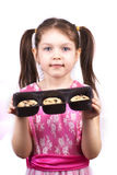 Image with little girl holding box of cookies. Little pretty girl holding box of cookies over white stock photos