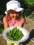 The little girl with a plate of peas Stock Photo
