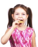 Image with little pretty girl eating cookie Royalty Free Stock Images