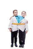 Image of little twin boys pretending siamese Royalty Free Stock Photography