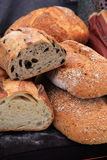 Image of loaves of fresh baked breads, some cut in half. Image of several loaves of bread, some cut open for buyers to see how fresh they are, just baked and put royalty free stock photography