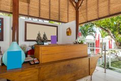 Beautiful lobby area at cheap hotel. Image of lobby area at cheap hotel in Bali. Photographed during day time with traditional style reception royalty free stock image