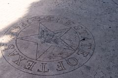 Lone Star of Texas Silver emblem on sidewalk concrete stock photography