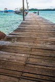 Image of long hardwood bridge over the sea in Thailand Royalty Free Stock Photo