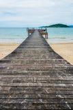 Image of long hardwood bridge over the sea Stock Photo