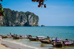 Beach with longtail boats at Ao Nang beach. Image of longtail boats to transport tourists at the Ao Nang beach in Krabi Province, Thailand. With a clear sky and Royalty Free Stock Images