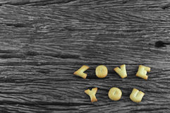 Image of Love You made from cookie on wooden board Stock Images