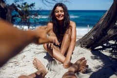 Image of a loved make touches his girlfriend`s, have funny times, on the beach of the Corsica. royalty free stock images
