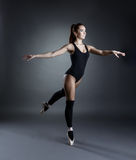 Image of lovely ballerina dancing in studio Stock Images