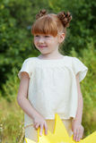 Image of lovely red-haired girl posing in park Royalty Free Stock Images