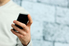Image of a male hand holding smartphone Royalty Free Stock Photos