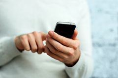Image of a male hand holding smartphone Stock Images