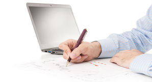 Image of male hand pointing at business document Royalty Free Stock Image