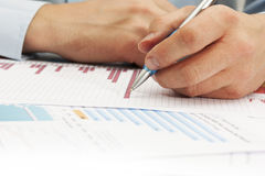 Image of male hand pointing at business document during discussion at meeting Royalty Free Stock Images