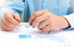 Image of male hand pointing at business document during discussion at meeting Royalty Free Stock Image