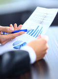Image of male hand pointing at business document during Stock Photo