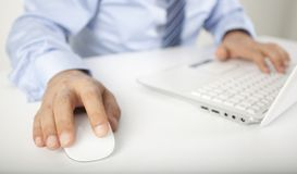 Image of male hand touching computer mouse and key Stock Photo