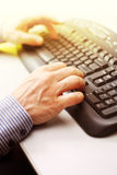 Image of male hands typing Stock Photo