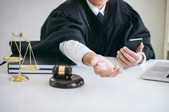 Image of Male lawyer or judge importune bribes client, working w Stock Image