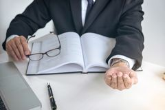 Image of Male lawyer or judge importune bribes client, working w Stock Images