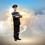Image of male pilot. With airplane flying around him Stock Image