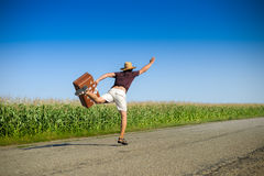 Image of male with suitcase rushing forward and Stock Image