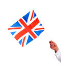 Image of males hand holding UK flag Royalty Free Stock Images