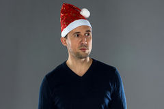 Image of man in christmas hat looking away Stock Photo