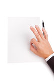 Image of man hand shows OK over white blank paper Stock Images