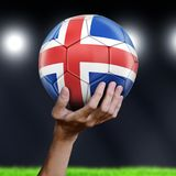 Man holding Soccer ball with Icelandic flag Stock Photo