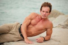 Image of a man laying on the rocks Royalty Free Stock Images