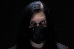 Image of the man with long hair in mask Royalty Free Stock Images
