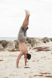 Image of a man performing a handstand Royalty Free Stock Photo
