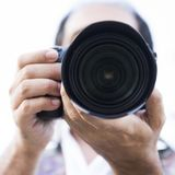 Image of a man photographing. Closeup of the machine Royalty Free Stock Images