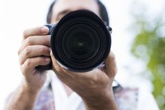 Image of a man photographing. Closeup of the machine Stock Photo