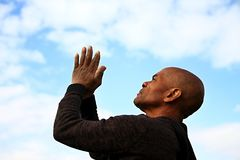 Praying with arms up to the sky Royalty Free Stock Images