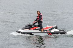 Man riding a jet ski. Image of man riding a jet ski royalty free stock images